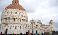 Piazza dei Miracoli. The Piazza dei Miracoli (Italian: Square of Miracles), formally known as Piazza del Duomo (Italian: Cathedral Square), is a wide walled area located in Pisa, Tuscany, Italy, recog
