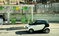 A smart car at a gas station in Naples. We were driving by on the tour bus and I had to get this picture. These cars are everywhere in Italy and most of the cars over there actually run on diesel.