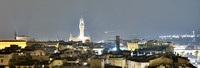 A wider angle of the Florence skyline at night