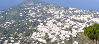A view of Capri village from the top of Monte Solaro. A high dynamic range picture of the village of Capri from Monte Solaro with the Gulf of Naples in the background.